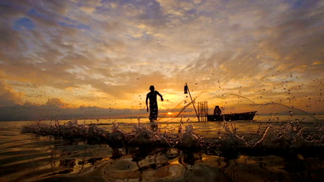 slow motion of local lifestyles of fisherman working in the morning sunrise. - fishing video stock e b–roll