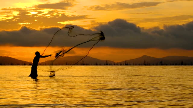 Slow motion of Local lifestyles of fisherman working in the morning sunrise. video