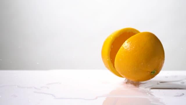 Slow motion of Orange slice drop and splashing