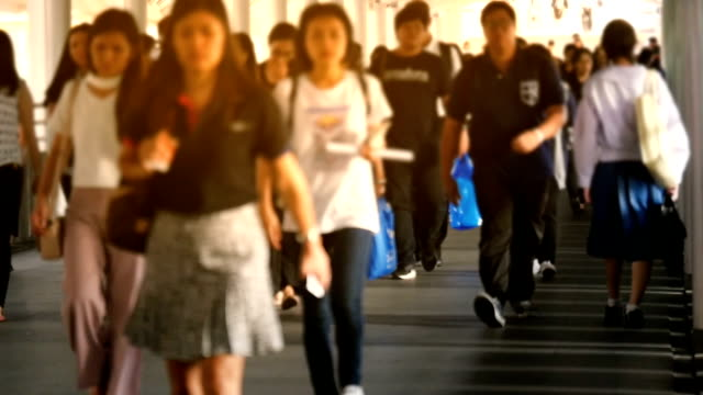 Slow motion of people walking on city video