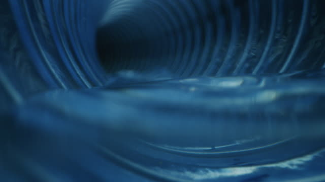 Slow motion of pipe tube inside view of water cleaning process of domestic and industrial waste sewers and organic pits with anti-limescale and degreasing products