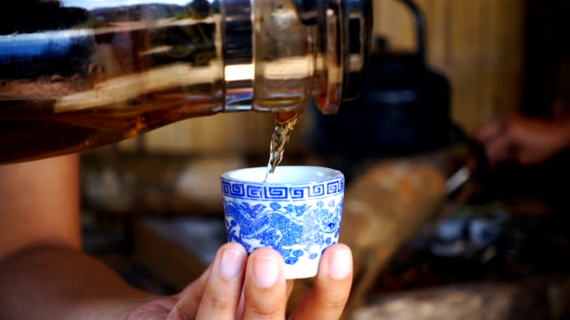 slow motion of pour tea into cup of tea ancient - porcellana video stock e b–roll