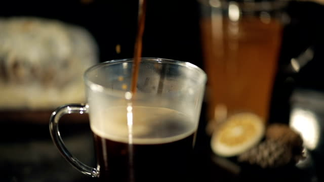 Slow motion of pouring coffee into cup video