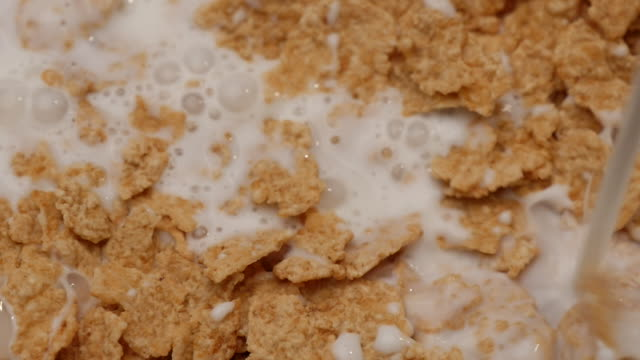 Slow motion of Pouring milk to cornflakes video