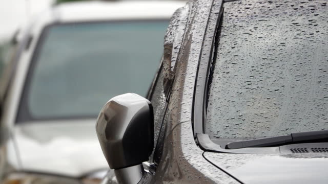 Slow motion of Rain on Car Slow motion of Rain on Car stationary stock videos & royalty-free footage