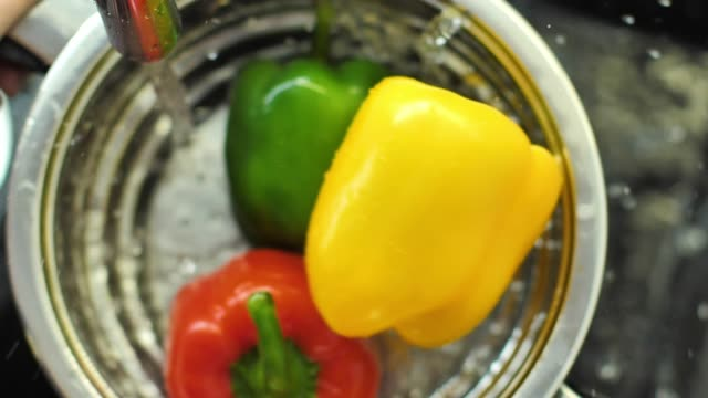 Slow Motion Of Red, Green Bell Pepper Drop In The Water video