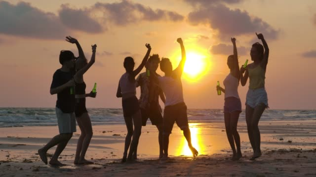 Slow motion of silhouette group of young people dancing at beach party on sunset. Dancing, Multi-Ethnic Group, Music Festival, Summer, Party - Social Event east asian ethnicity stock videos & royalty-free footage
