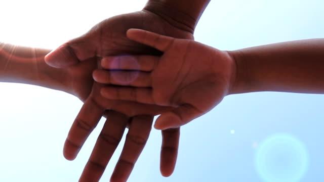 Slow motion of Team Hand stack loop video