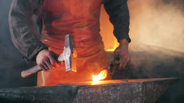Slow motion of the blacksmith forging iron Slow motion of the blacksmith forging iron . HD anvil stock videos & royalty-free footage