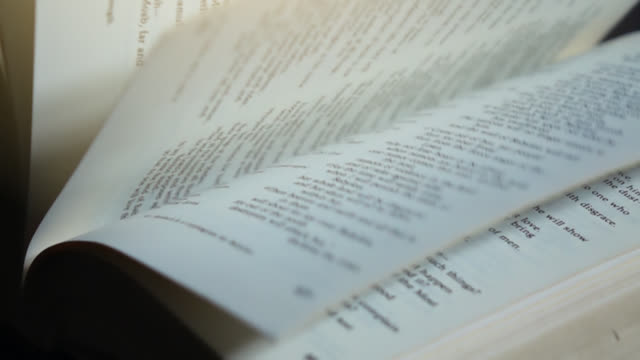 Slow motion of turning pages of book