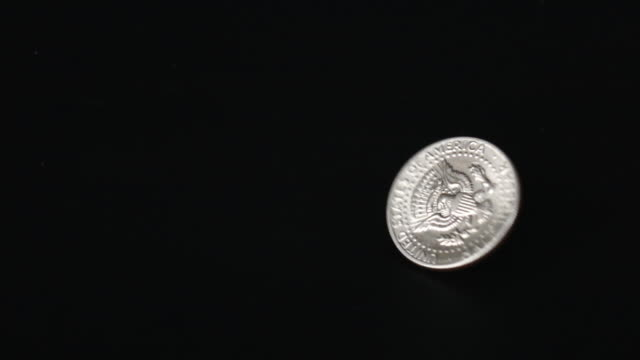 Slow Motion of US Dollar Coin Rotating Slow Motion of 50 US cent Dollar Coin Rotating us coin stock videos & royalty-free footage