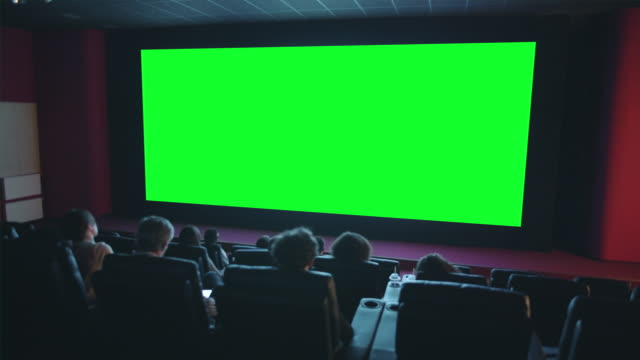 slow motion of viewers clapping hands looking at green chroma key cinema screen - movies filmów i materiałów b-roll