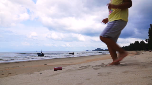 Slow motion of Waste Recycle on the Beach, drink cans.