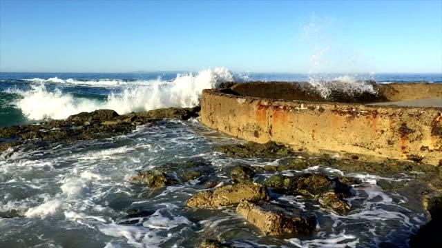 Slow motion of water bitting sea wall video