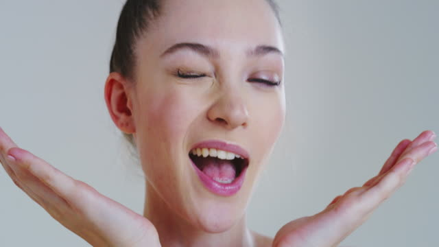 Slow motion of woman with beautiful face with perfect skin just cleaned from impurities ready for day or night cream is smiling in camera Slow motion of woman with beautiful face with perfect skin just cleaned from impurities ready for day or night cream is smiling in camera. serum sample stock videos & royalty-free footage