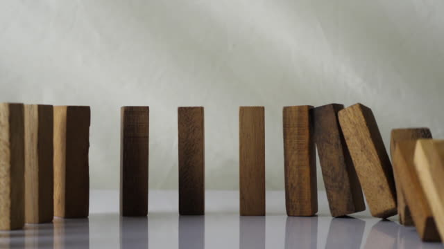 slow motion of Wooden blocks falling in line slow motion of Wooden blocks falling in line solid stock videos & royalty-free footage