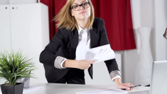 Slow Motion Of Young Businesswoman Throwing Papers Into Camera video