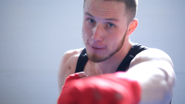 slow motion of young fighter - allenamento con l'ombra video stock e b–roll