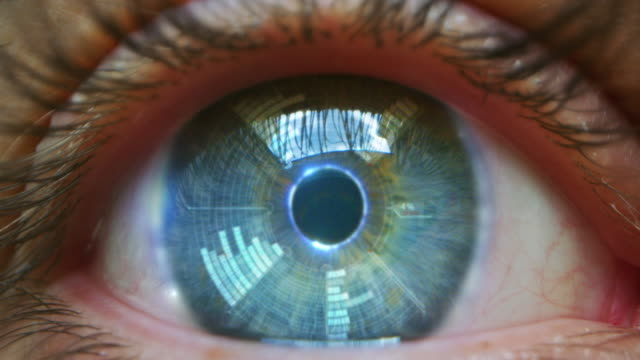 Slow motion of  young male blue eye with high technology  futuristic virtual reality for personal safety scanning