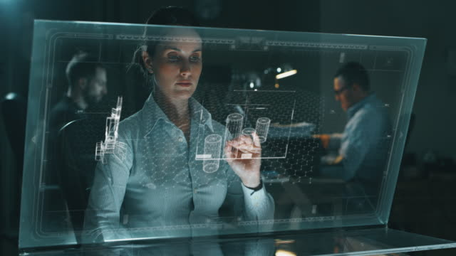 Slow motion of young woman modern  designer using augmented reality sophisticated and futuristic programs with holography.