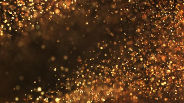 vídeos y material grabado en eventos de stock de partículas de cámara lenta (oro oscuro) - loopable - anniversary