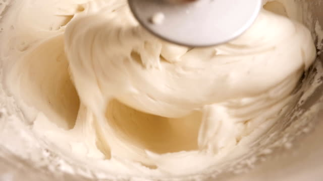 Slow Motion Pastry Cream Whipped by an Electric Mixer - 4K video
