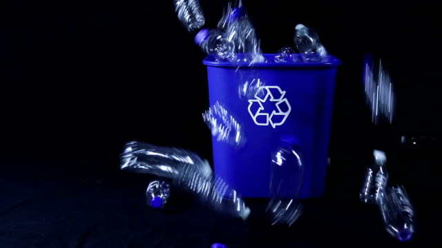 slow motion plastic bottles being dumped in bin - recycling stock videos & royalty-free footage
