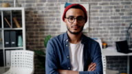 istock Slow motion portrait of male designer looking at camera and smiling in office 1150437876