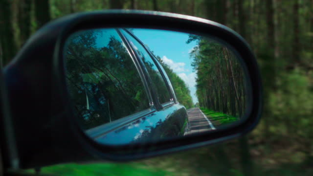 Slow motion: Road on a side mirror Slow motion: Road on a side mirror rear view mirror stock videos & royalty-free footage
