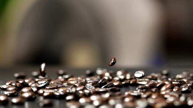 Slow Motion Roasted Coffee Beans With Coffee Dust Falling