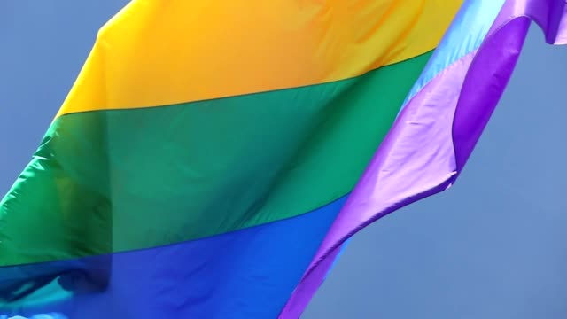 Slow Motion San Francisco Rainbow Flag Flying High quality 1280p resolution stock video of a large rainbow flag flying in San Francisco during pride week in San Francisco California. lgbtqi rights stock videos & royalty-free footage