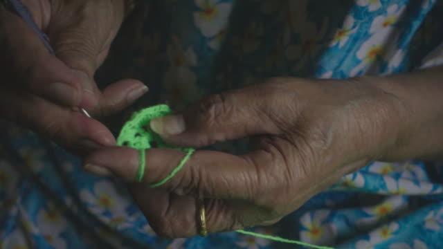 slow motion : senior woman knitting video