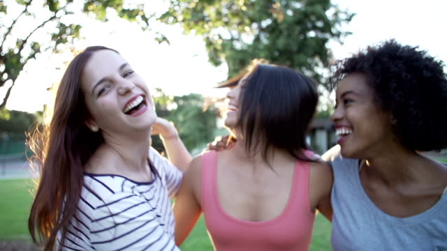 Slow Motion Sequence Of Female Friends Having Fun In Park Slow motion shots of three female friends laughing and having fun in park together.Shot on Sony FS700 at frame rate of 100fps only young women stock videos & royalty-free footage