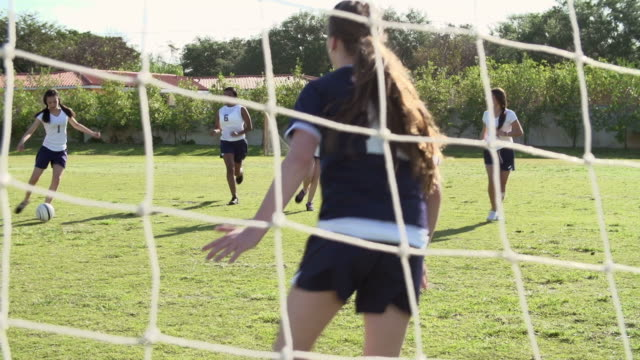 Slow Motion Sequence Of Female High School Soccer Team Match video