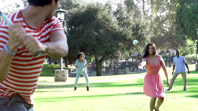 Slow Motion Sequence Of Friends Playing Baseball In Park video