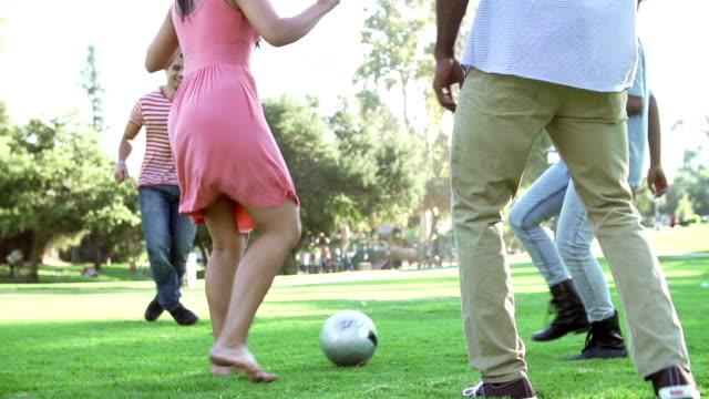 Slow Motion Sequence Of Friends Playing Soccer In Park video