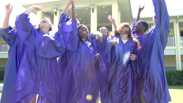 slow motion sequence of high school students at graduation - graduation stock videos and b-roll footage