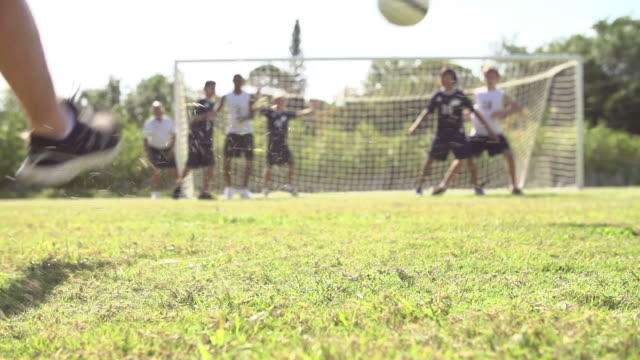 Slow Motion Sequence Of Male School Soccer Team Scoring Goal video