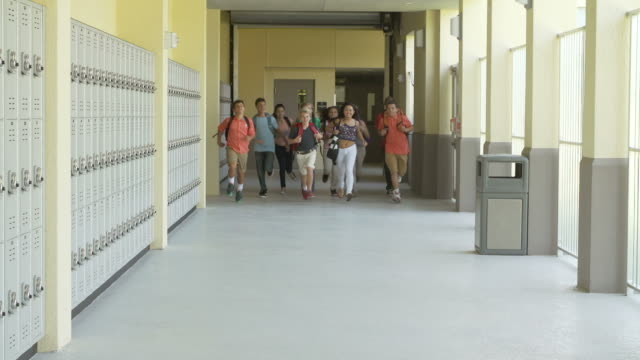 Slow Motion Sequence Of School Students Running In Hallway video