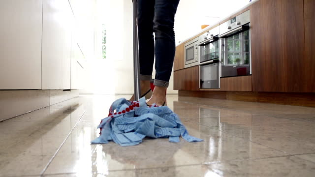 Slow Motion Sequence Of Woman Mopping Kitchen Floor video