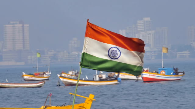 Slow motion shot of an Indian flag waving mouted on a fishing boat video