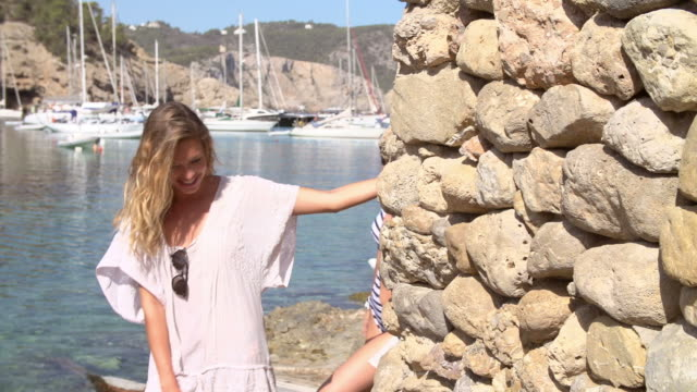 Slow Motion Shot Of Female Friends Walking By Harbour video