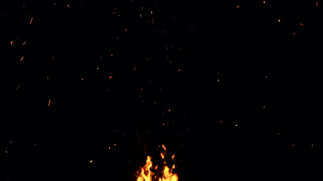 slow motion shot of fire flames and glowing ash particles on black background ultra slow motion high speed shot of fire flames and glowing ash particles on black background hell stock videos & royalty-free footage
