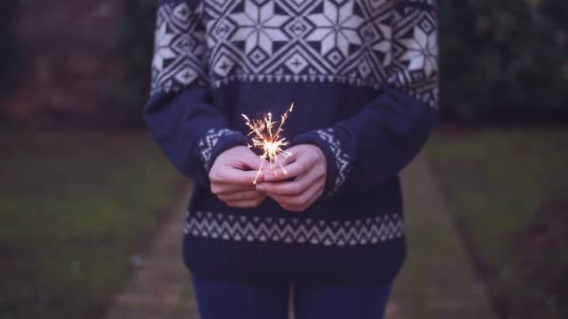 slow motion shot of girl holding a sparkler in her hands video