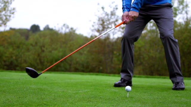 Slow motion shot of golfer driving a golf ball video