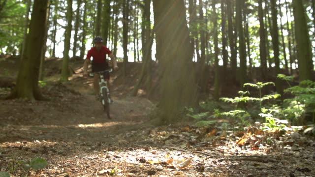 Slow Motion Shot Of Man Riding Mountain Bike Skidding video