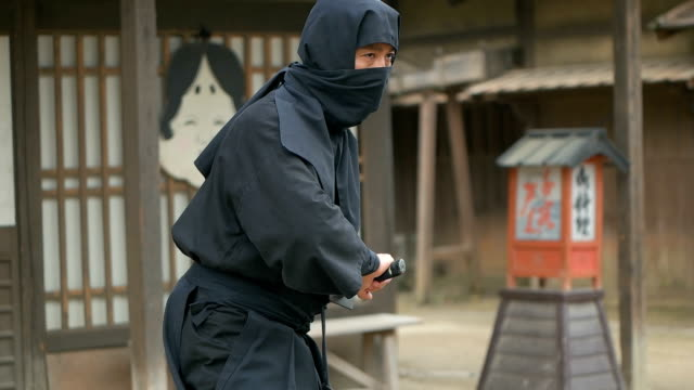 Slow motion shot of Ninja in old town. Slow motion shot of Ninja in old town. ninja stock videos & royalty-free footage
