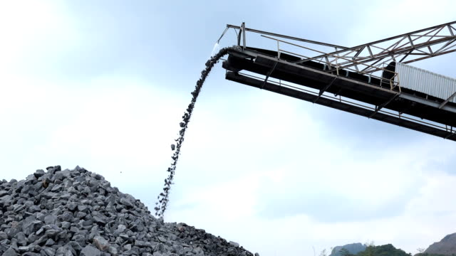 Slow motion shot of quarry mine industry rock extraction heavy machinery equipment video