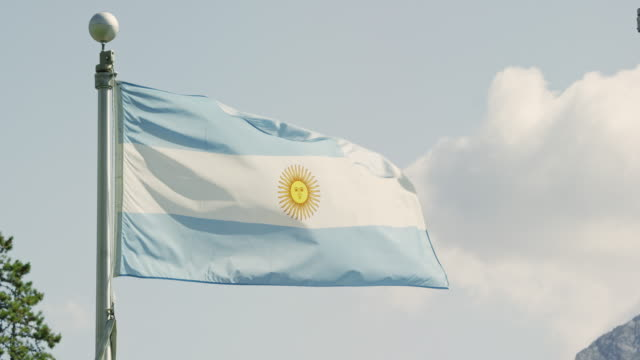 Slow Motion Shot of the Flag of Argentina Blowing in the Wind on a Sunny Day