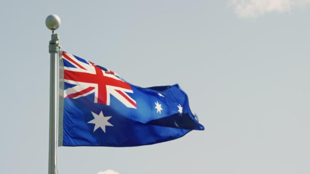 Slow Motion Shot of the Flag of Australia Blowing in the Wind on a Sunny Day